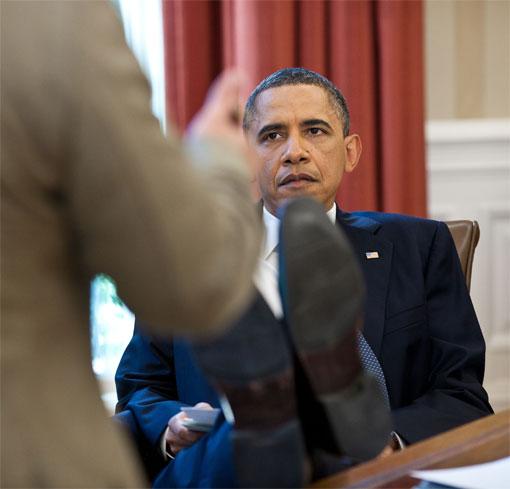 Obama feet up talking to someone