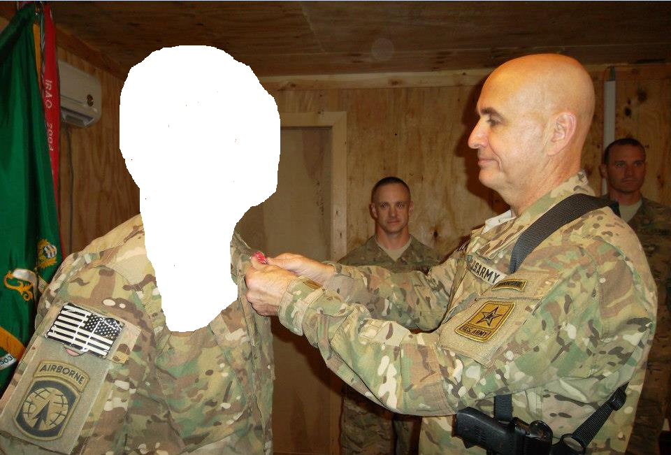 Quantock giving award to soldier from FOB Kandahar